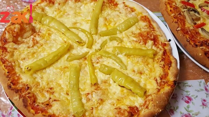 طريقة البيتزا وأسرار المذاق الرائع مثل الإيطالية
