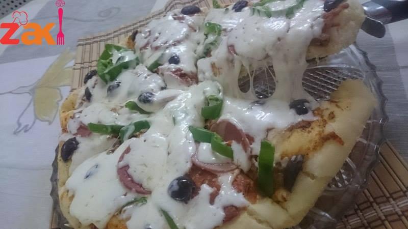 بيتزا تستحق التجربة اللي بحب البيتزا يشجعني