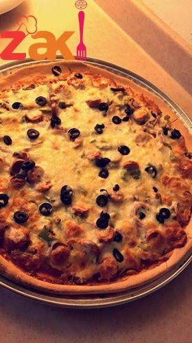 بيتزا روعة جداً والعجينة قطنية وخفيفة