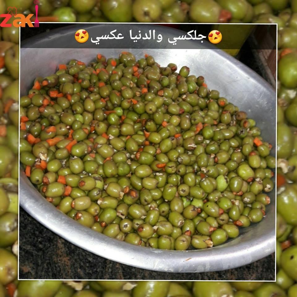 من أرض فلسطين وزيتونها المبارك بقدملك أسهل وأنجح وصفة لكبس الزيتون المحشي لعدة سنوات