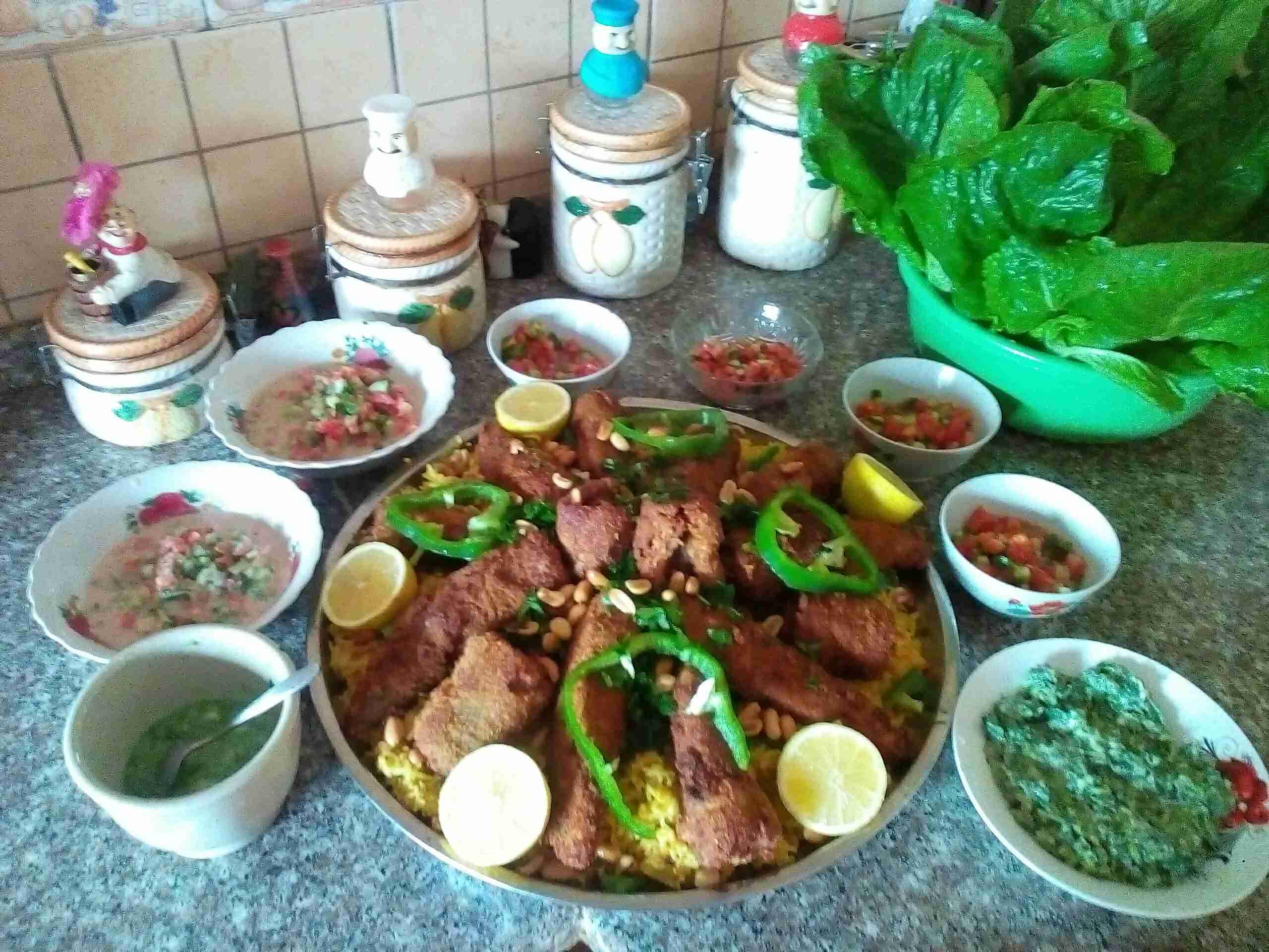 سمك مقلي مع ارز الكبسه